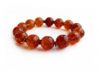 RED AMBER BEADED BRACELET WITH METAL FLOWERS