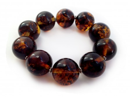 MULTICOLORED AMBER BRACELET WITH METAL FLOWERS