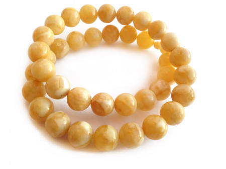 Necklace With Pressed White Amber Beads: 16mm