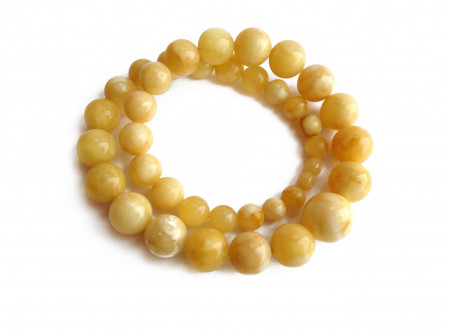 Necklace With Pressed White Amber Beads: 9mm - 19mm
